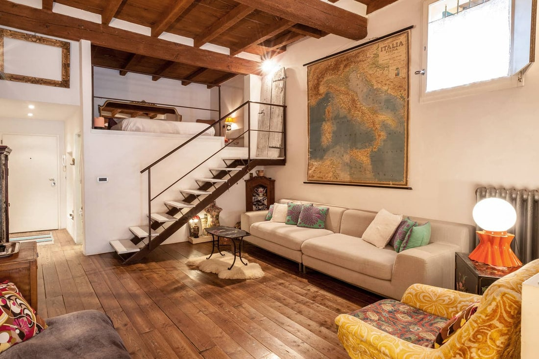 Best Airbnb in Bologna - sofa with map