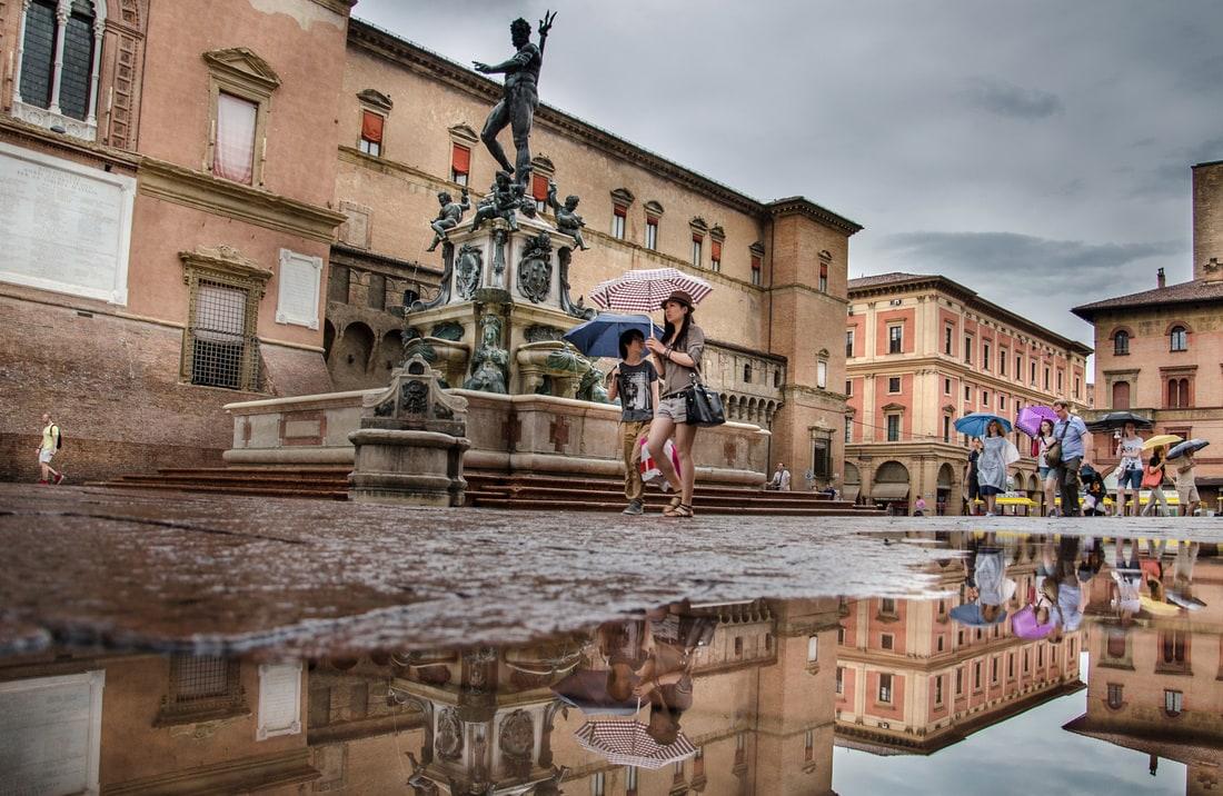 Piazza Maggiore in Bologna under the rain