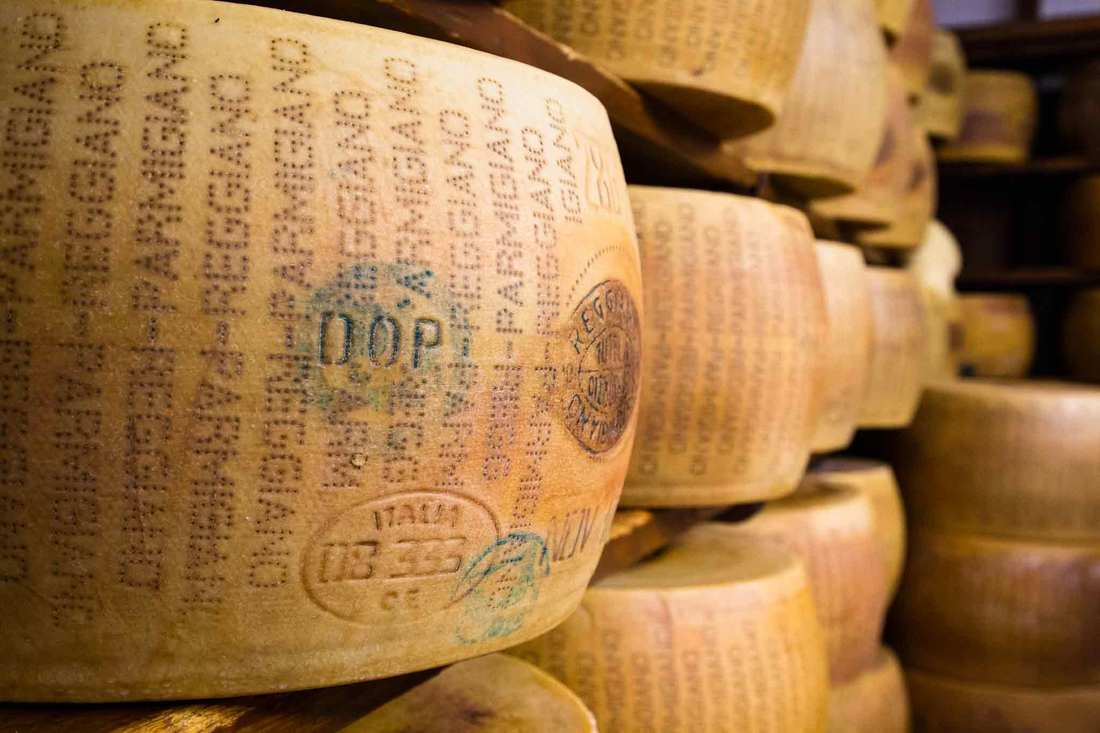 Parmigiano Reggiano cheese - aging wood shelves